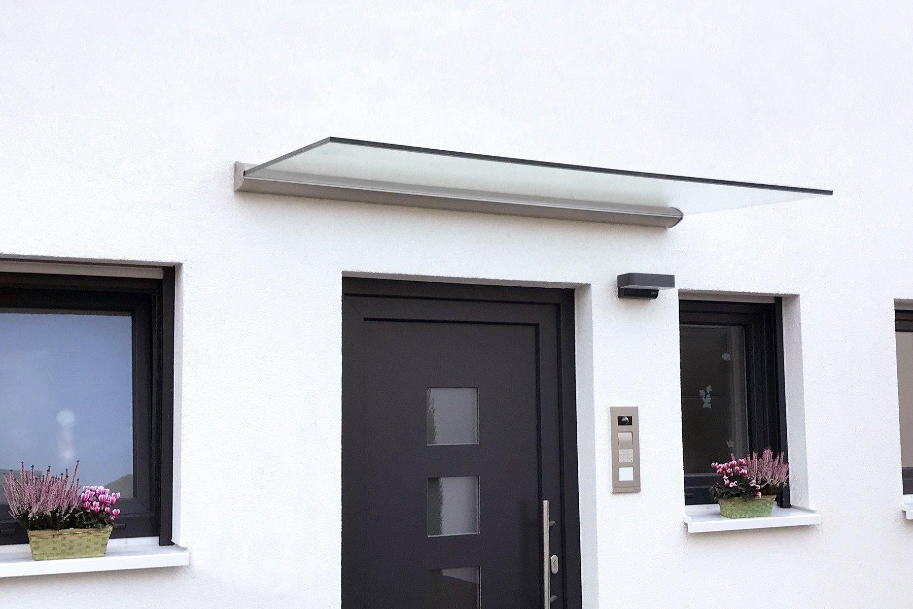 Vordach aus Glas freitragend