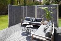 Gabionenzaun aus Steinen als Abgrenzung und Wind Lärm und Sichtschutz für die Terrasse maßgefertigte Ausführung im schmalen Design
