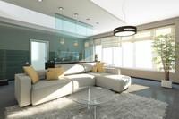 hellblaue-glastrennwand-zwischen-offener-küche-und-wohnbereich